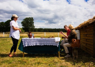 Laid table on the field Belarus