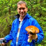 German tourist with the big mushroom Belarus